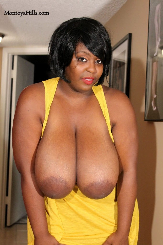 Montoya Hills shows off her big black tits and deep cleavage.  She has amazing large areolas and nipples.