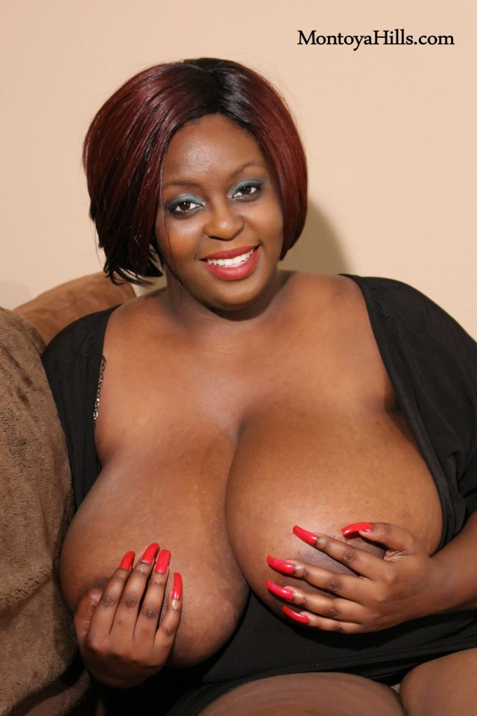 Ebony milf, Montoya Hills does a hand bra with her sinfully long fingernails.