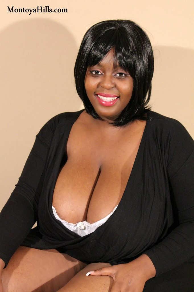 Montoya Hills, the ebony milf, shows off her big black tits deep cleavage.