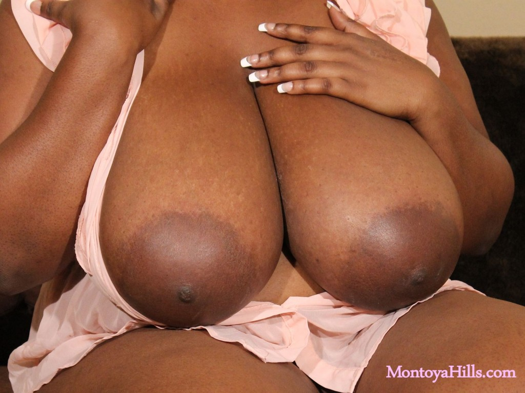 Close-up look at the huge black boobs of Montoya Hills.