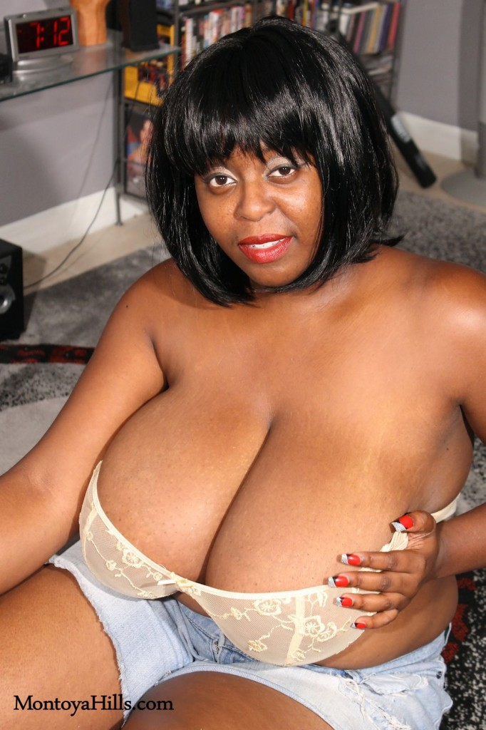 Big tit ebony beauty, Montoya Hills,  removing her bra and exposing her boobs.