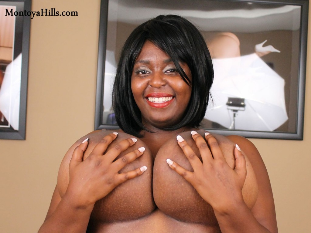 Montoya Hills cups her huge black boobs creating a hand bra..