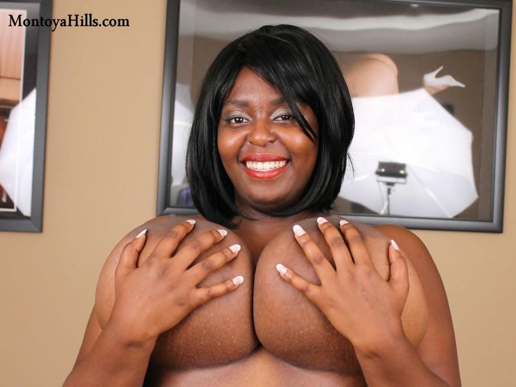 Montoya Hills cups her huge black boobs creating a hand bra..