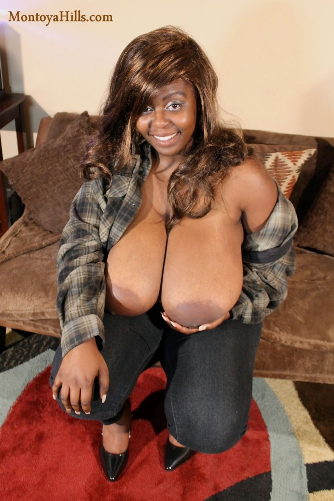 Montoya Hills exposes her huge slopping boobs in jeans, high heels and flannel shirt.