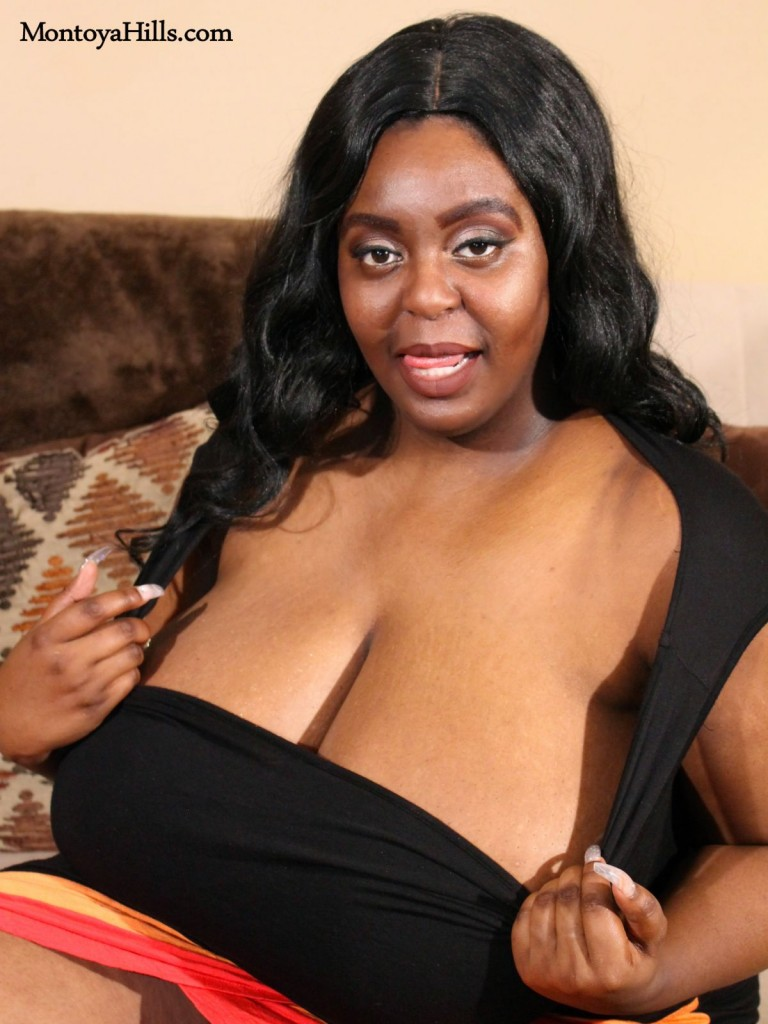 Big tit African-American  babe shows deep cleavage.